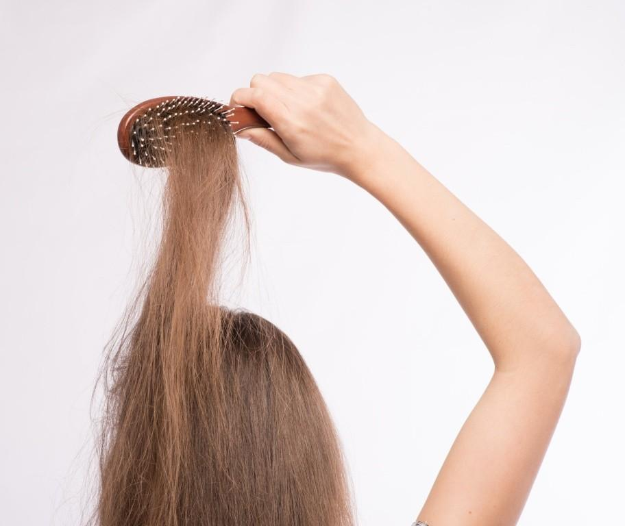 thyroid screening hair loss brushing hair image