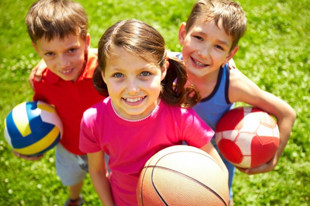 children's health group of kids with sports equipment image