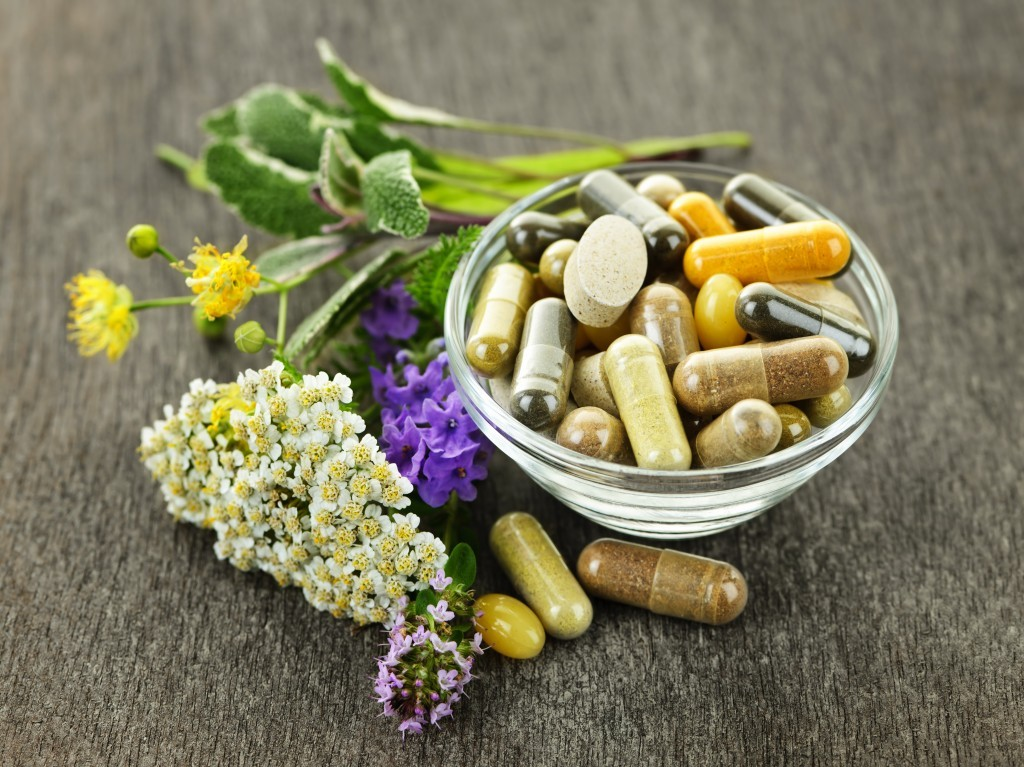 swallowing pills herbal medicine caps in a bowl image