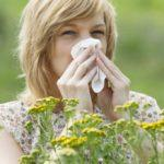 allergy season woman blowing nose image