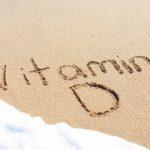 vitamin D written in sand at a beach