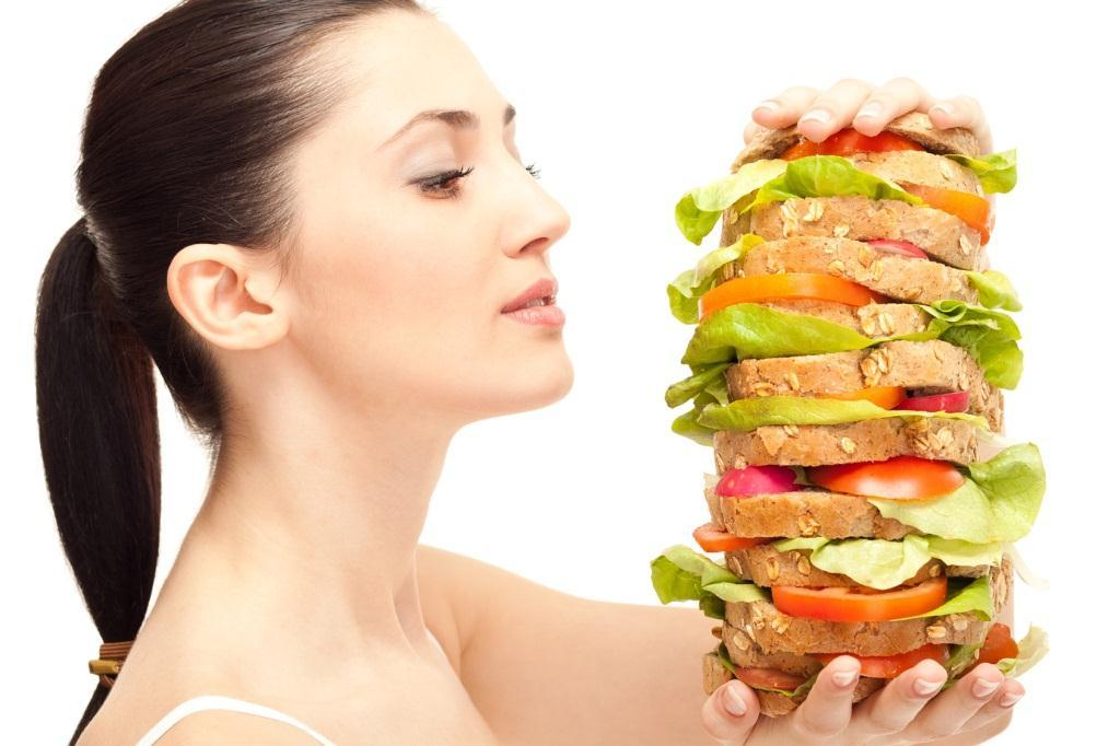 hungry woman looking huge sandwich