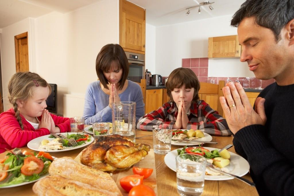miracle of ritual family saying grace before meal image