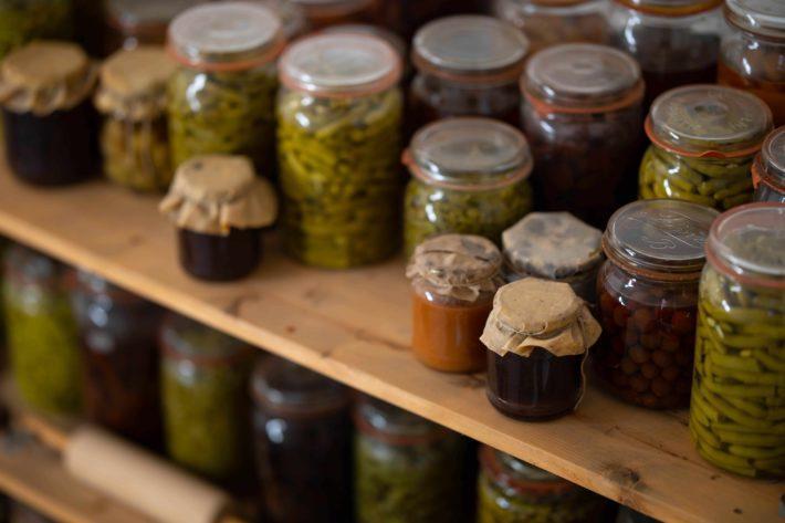 Jars of pickled vegetables on shelves