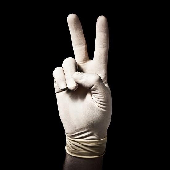 gloved hand peace sign image