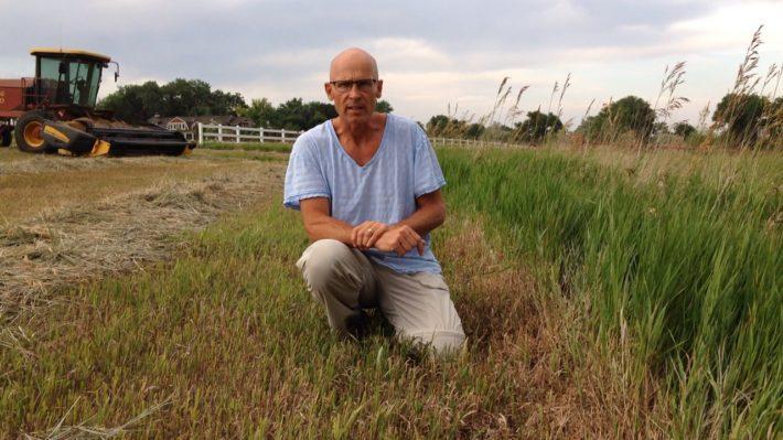 john-kneeling-in-austrian-pasture_image