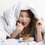 lifespa image, woman sneaking dessert under covers