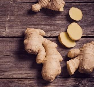 lifespa image, ginger root sliced on wooden table
