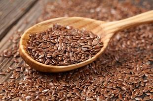 lifespa image, whole flax seeds and wooden spoon
