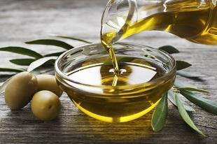 lifespa image, olive oil and olives pouring into glass bowl