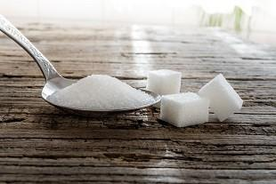 lifespa image, blood sugar, spoonful of sugar and cubes on wood table