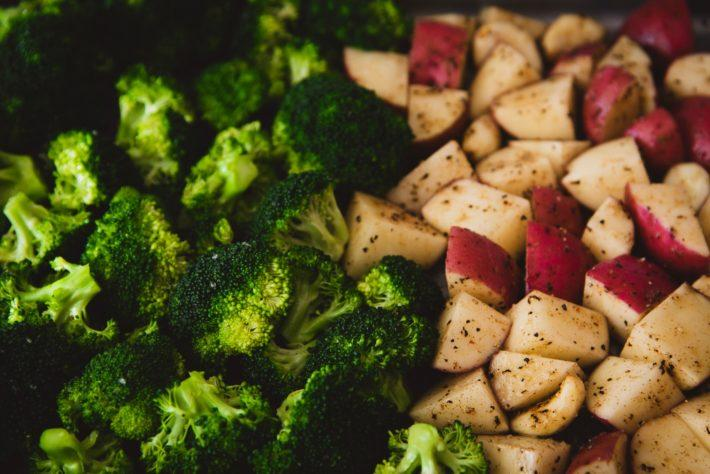 Cooked broccoli and apples