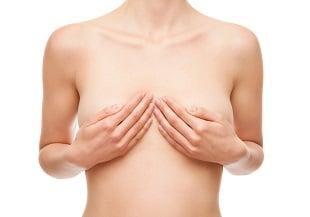 lifespa image, breast cancer, white woman covering breasts