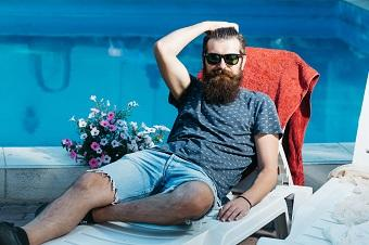 lifespa image, prostate health, bearded man sitting by pool with flowers