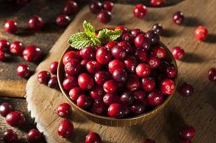 lifespa image, prostate health, cranberries on wooden table