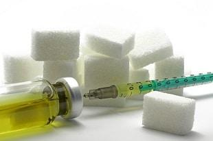 lifespa image, normal glucose levels, sugar cubes and insulin needle
