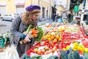 lifespa image, woman at farmer's market, happy, colorful food, fruits and vegetables