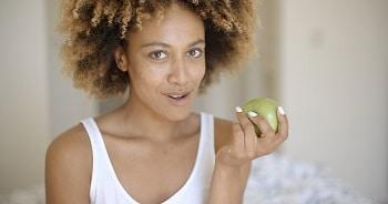 lifespa image, breast cancer, healthy woman eating green apple