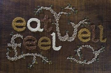 lifespa image, liver cleansing, herbs and spices spelling out eat well feel well on a wood backgroun