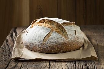 european bread vs american bread, freshly baked sourdough loaf