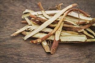lifespa image, whole licorice root on wooden table