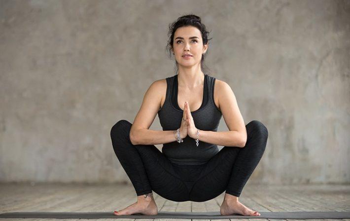 woman yoga squat frog pelvic floor strength