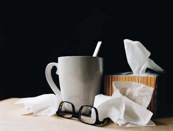 Kleenex and tea on a black background
