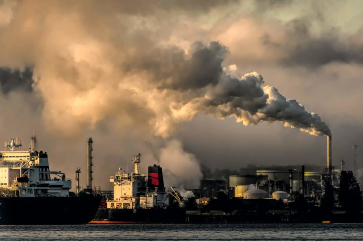 smokestacks and a polluted sky