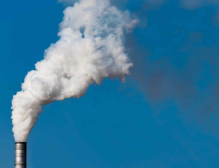 smokestack against a blue sky