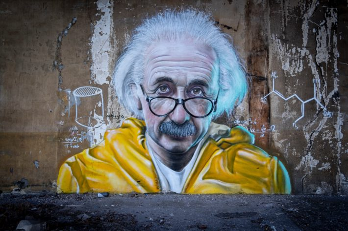 A mural of Albert Einstein in a yellow raincoat