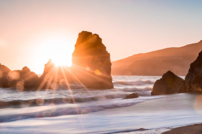 sunrise over the ocean and rocks