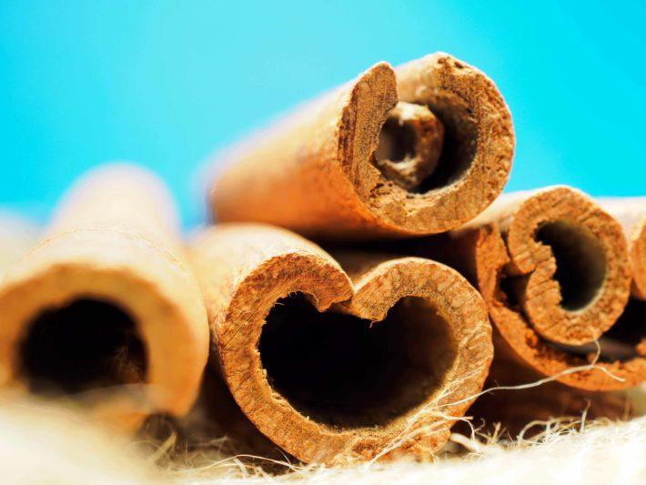 Closeup of cinnamon stick on a blue background