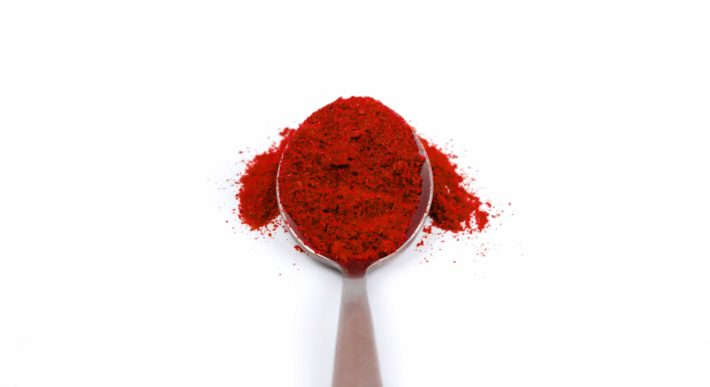 spoonful of red powder (manjistha)