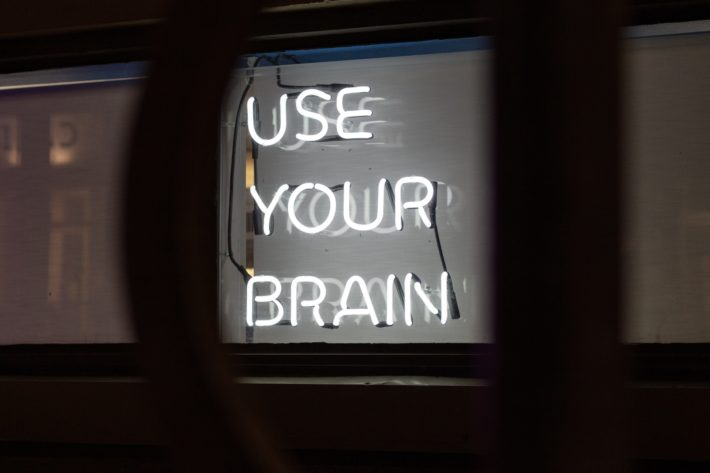"""Neon sign that says """"Use Your Brain"""""""