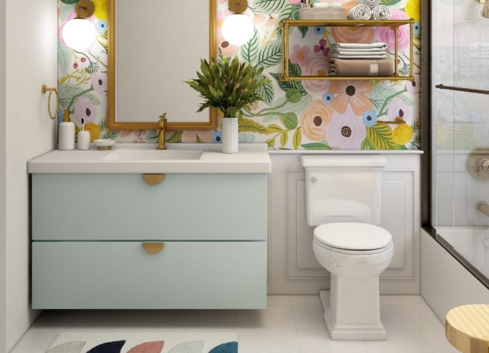 A phot of a blue and pink bathroom with wallpaper