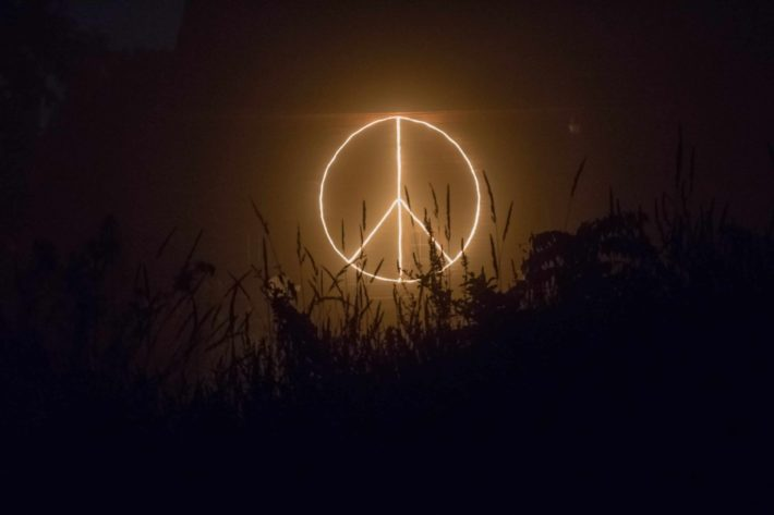 A peace sign made of nights at light