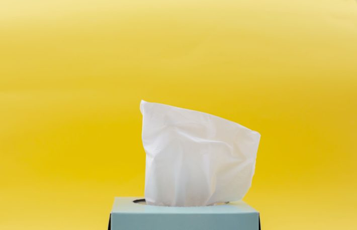 A box of tissue on a yellow background